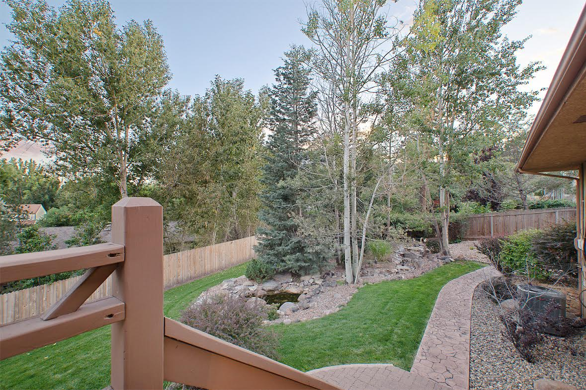 35 – Lush Serene Yard with Water Feature