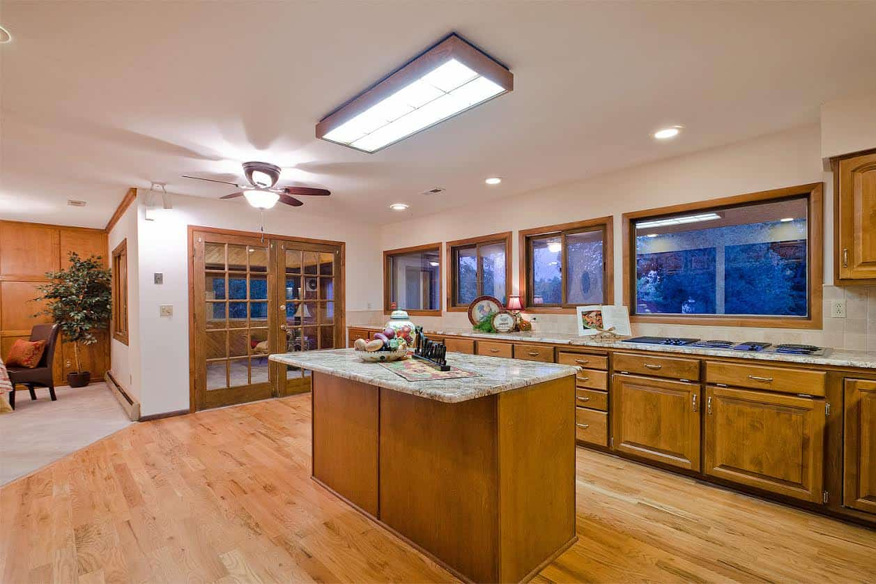 8 – Kitchen showing DR and Door to Sun Room