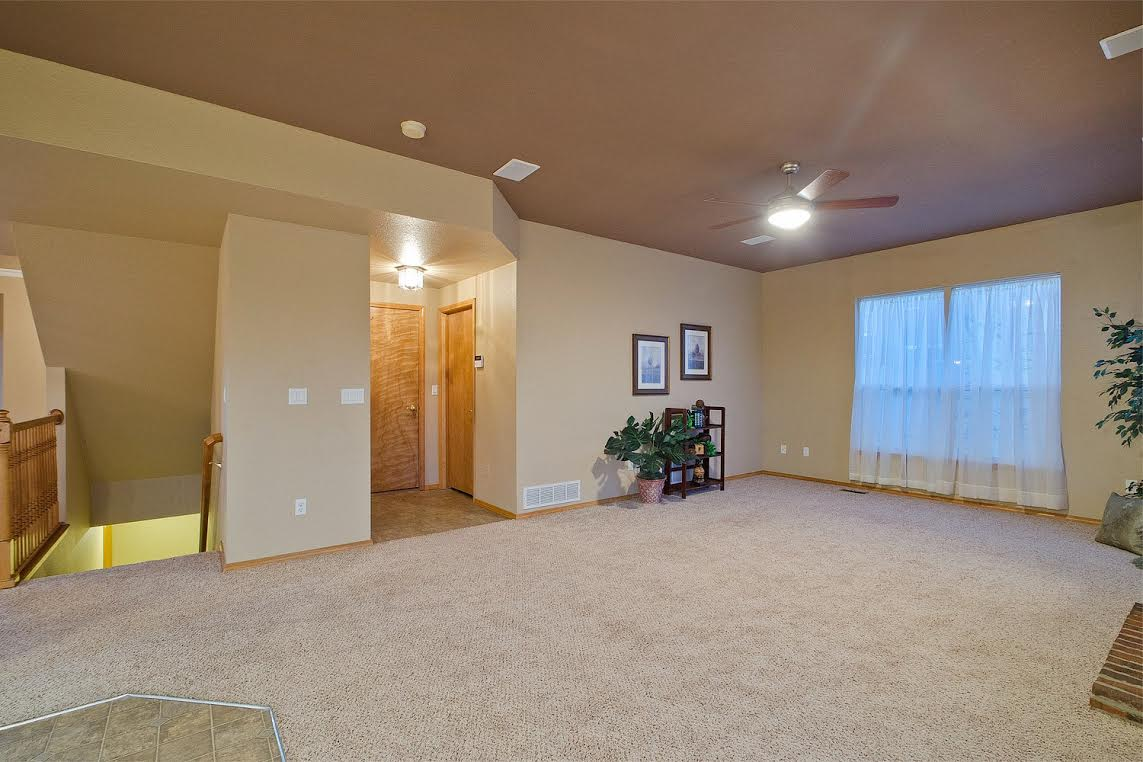 Family Room with Hallway to Laundry and Garage