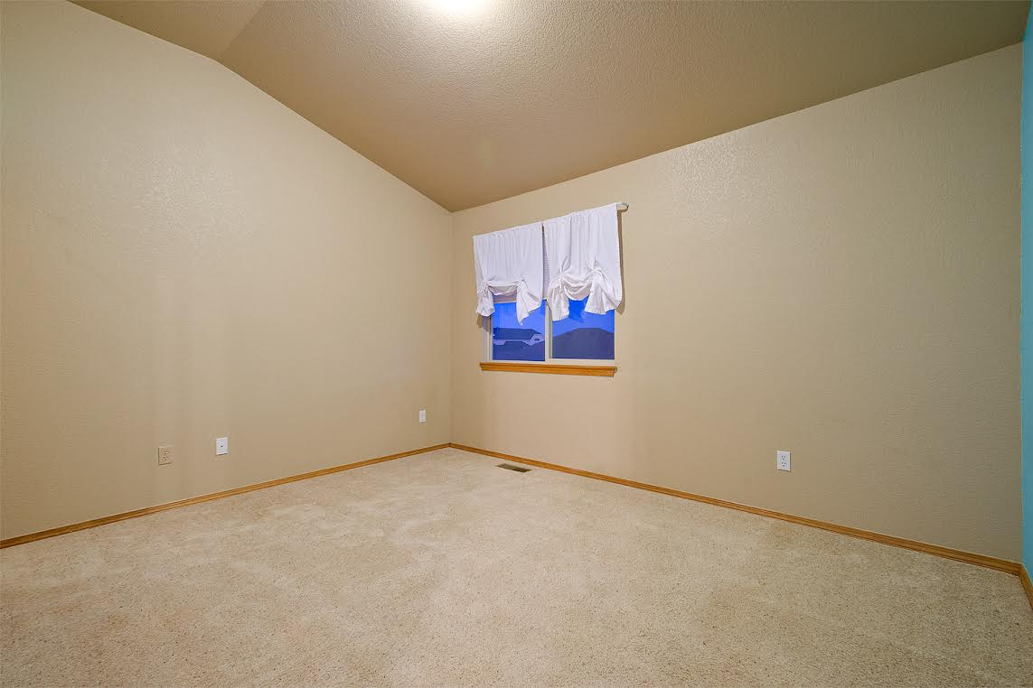 One of Three Upper Bedrooms