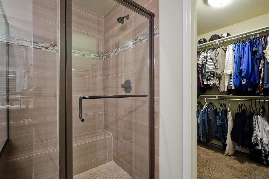 Decorative Tiled Shower and Walk-In Closet