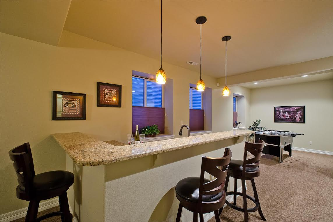 Wet Bar and Exteneded Recreation Room for Game Area