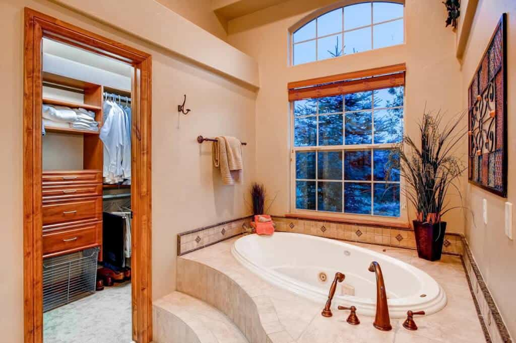 Jetted Soaking Tub and His/Her Closets with Built-in Organizers