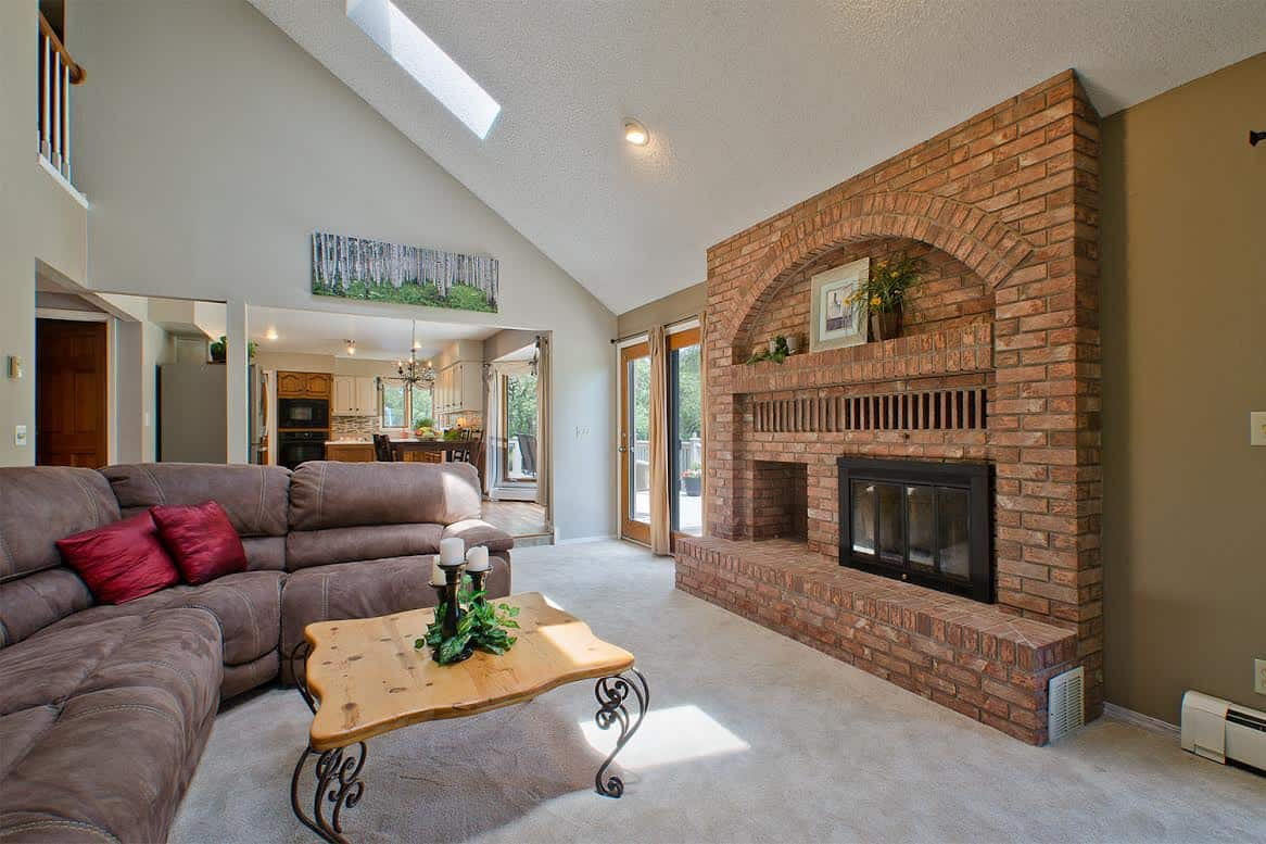 Family Room with Brick Fireplace off Kitchen and Nook