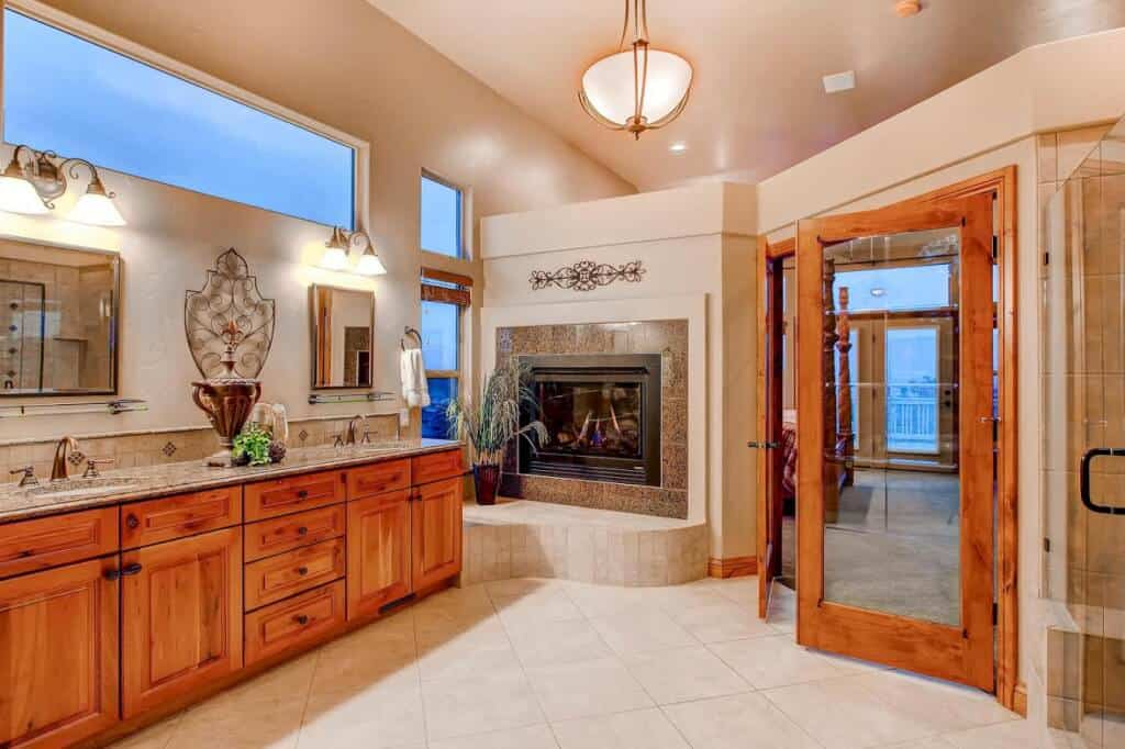 Granite Counters and Fireplace in Spa Bath