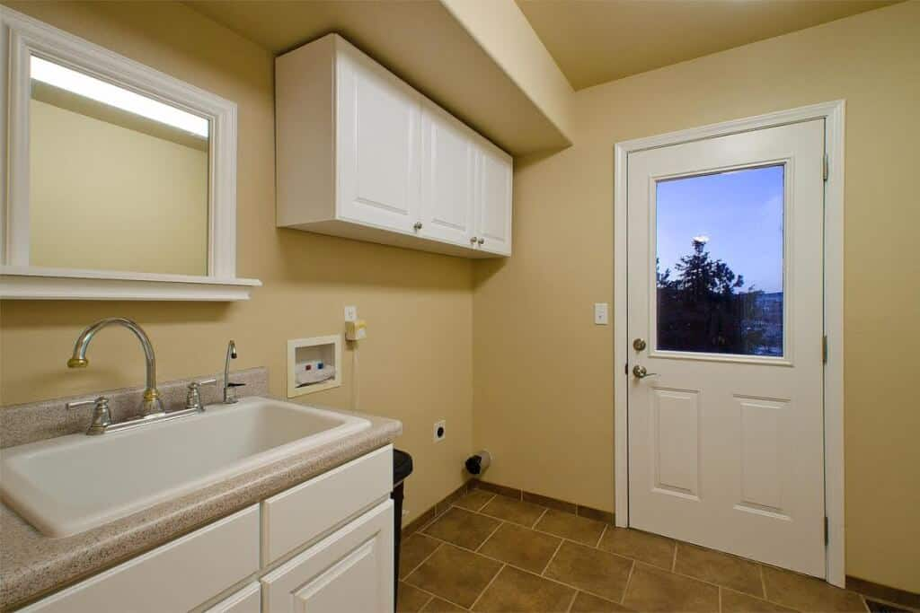 Main Level Laundry with Door to Dog Run