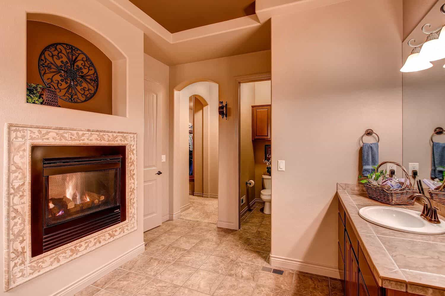 Gas Log Fireplace in Master Bathroom