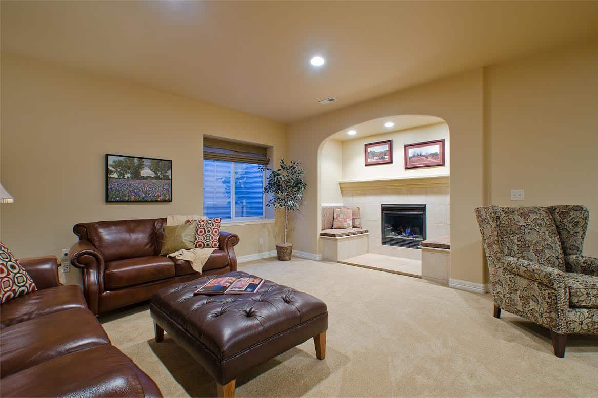 Recreation Room With Recessed Fireplace and Sitting Area