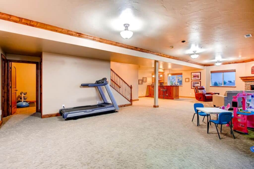 Large Open Rec Room with Door to Gym or Storage