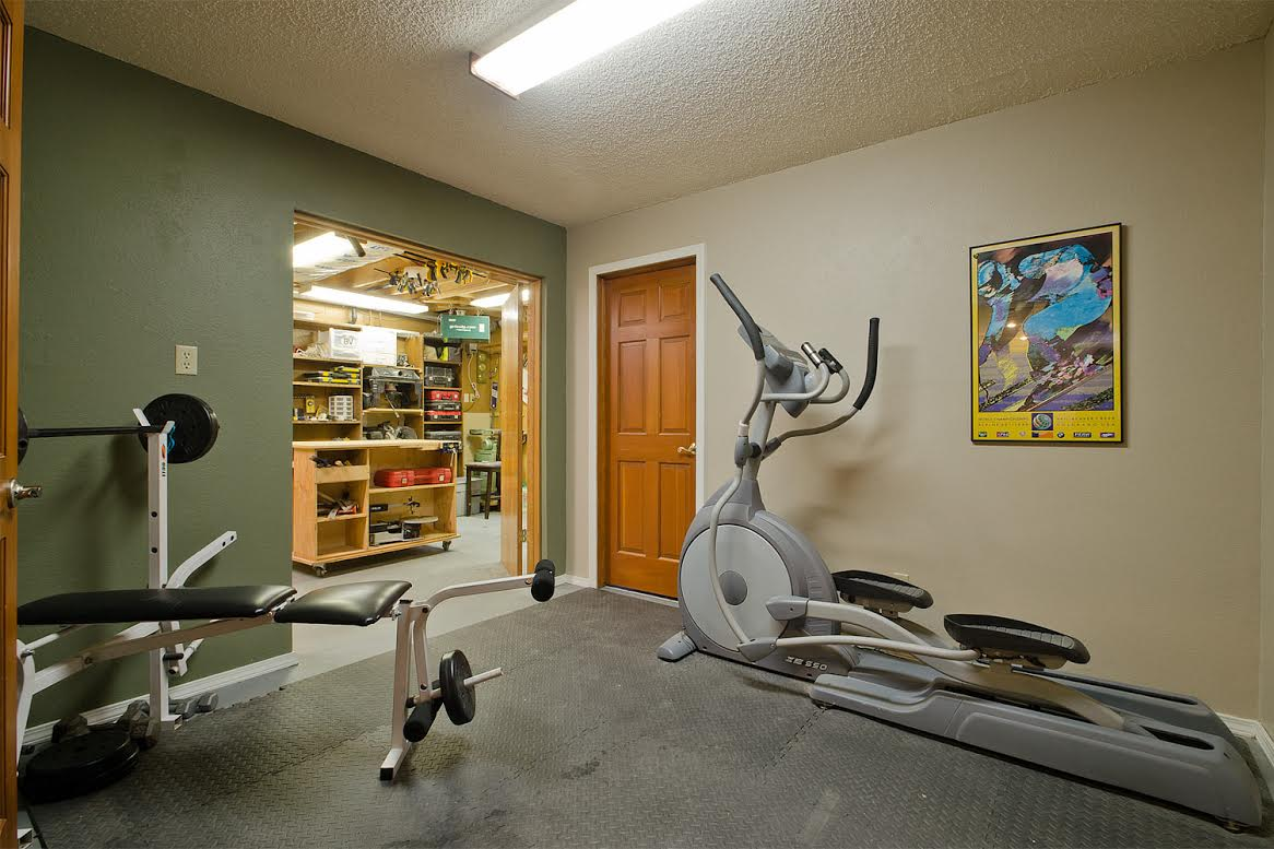 Basement Gym and View into Storage - Workshop