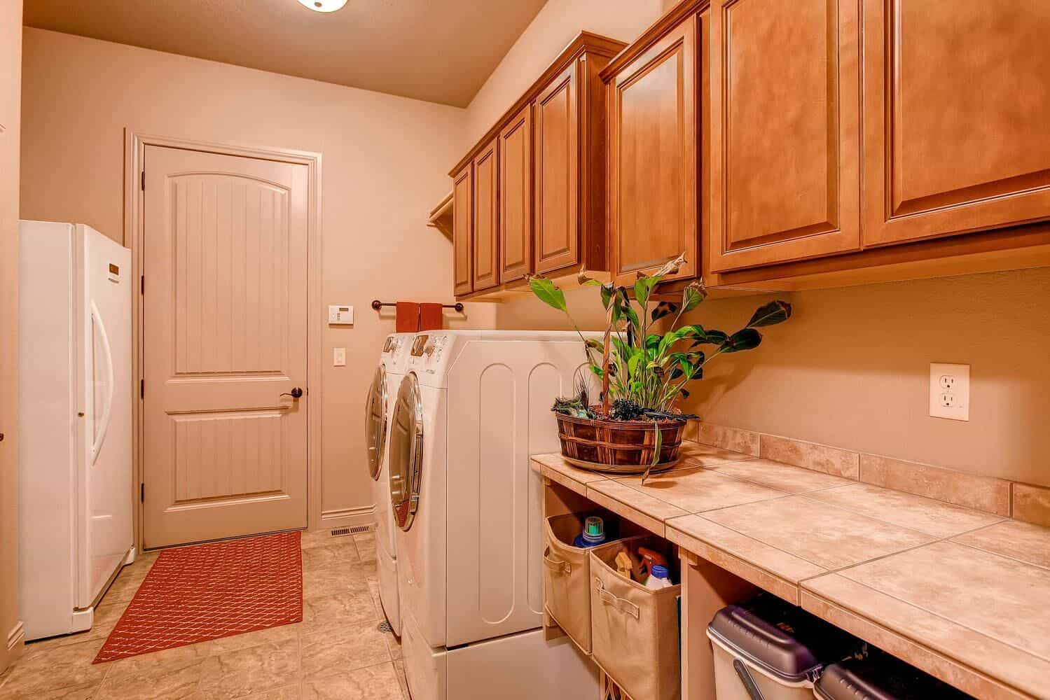 Master Level Laundry open to Master Bedroom with Sink