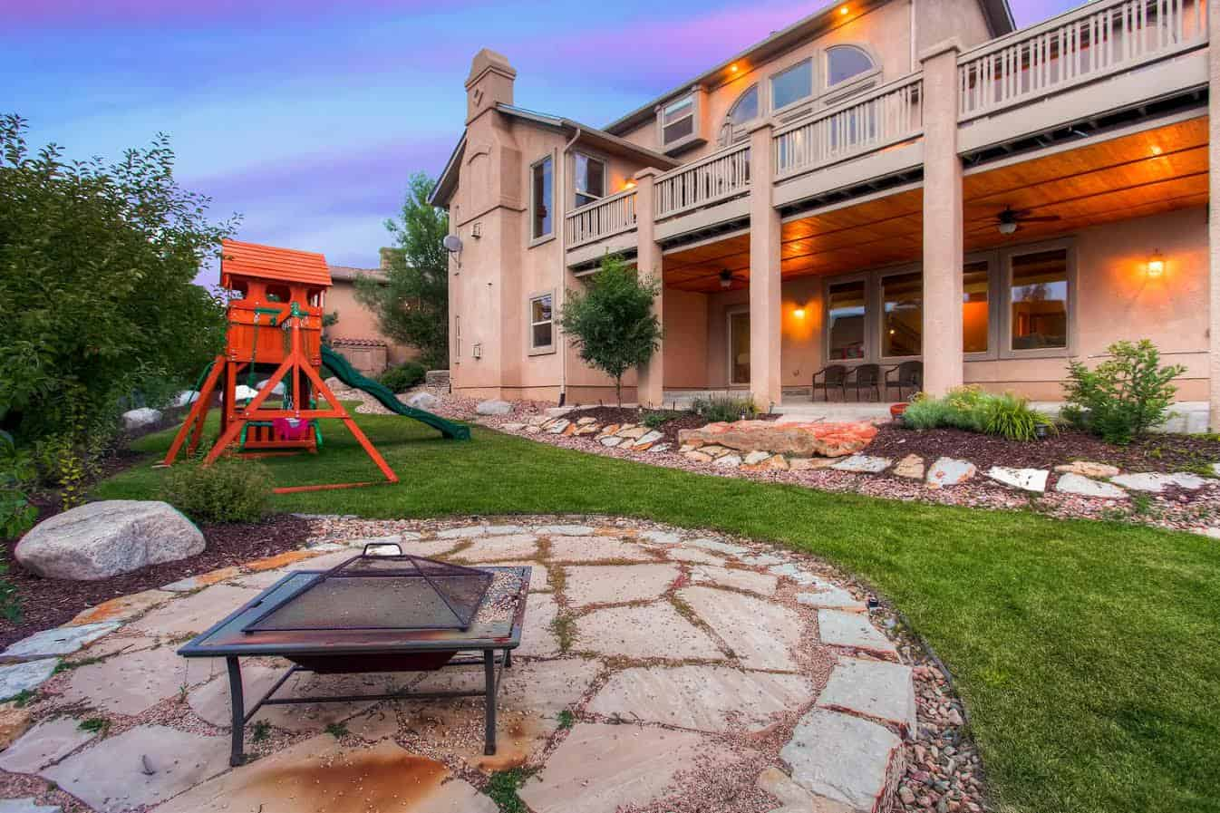 Backyard with Covered Patio, Deck and Playset