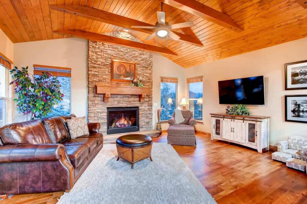 Walkout Family Room with Wood Ceiling and Fireplace