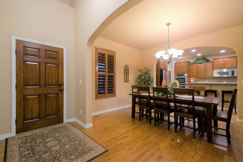 Entry opens into Formal Dining Room and Kitchen