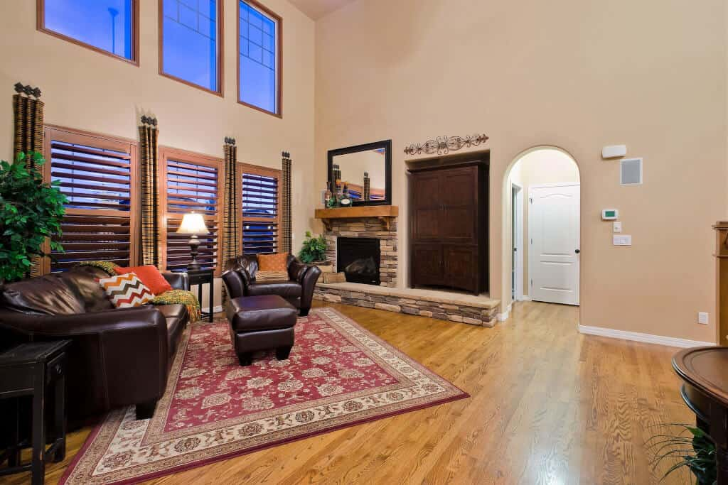 Great Room with Fireplace and Entry to MBR