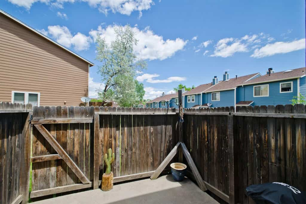 Fenced Backyard with Storage Closet