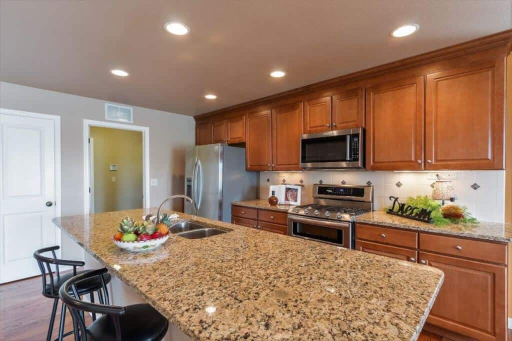 Kitchen with Undermount Lighting and Pantry