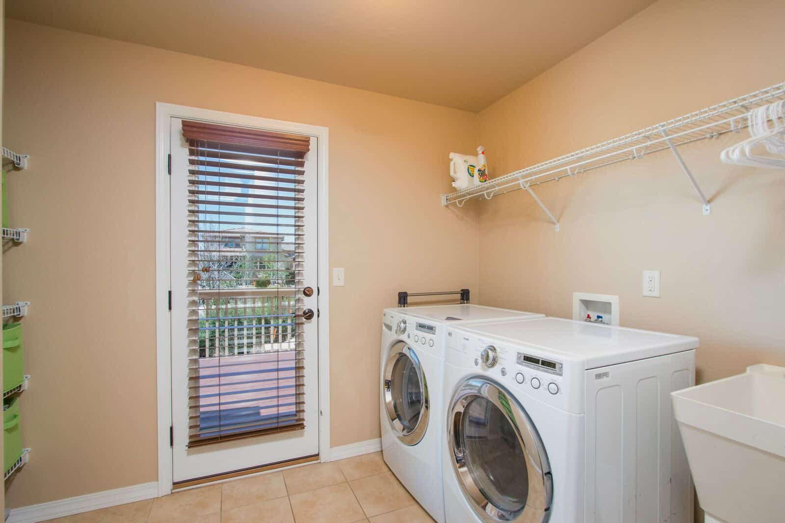 Main Level Laundry w/Sink and Walk Out to Deck