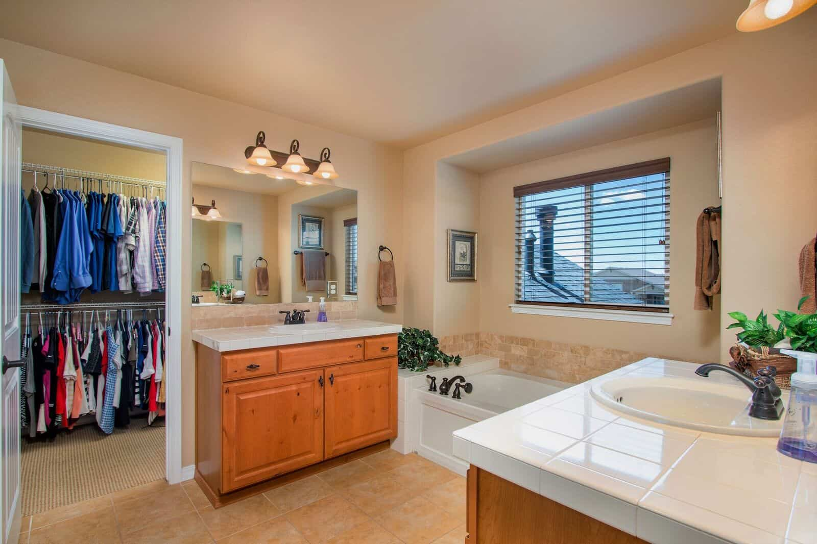 Master Bathroom with Dual Vanities and Walkin Closet