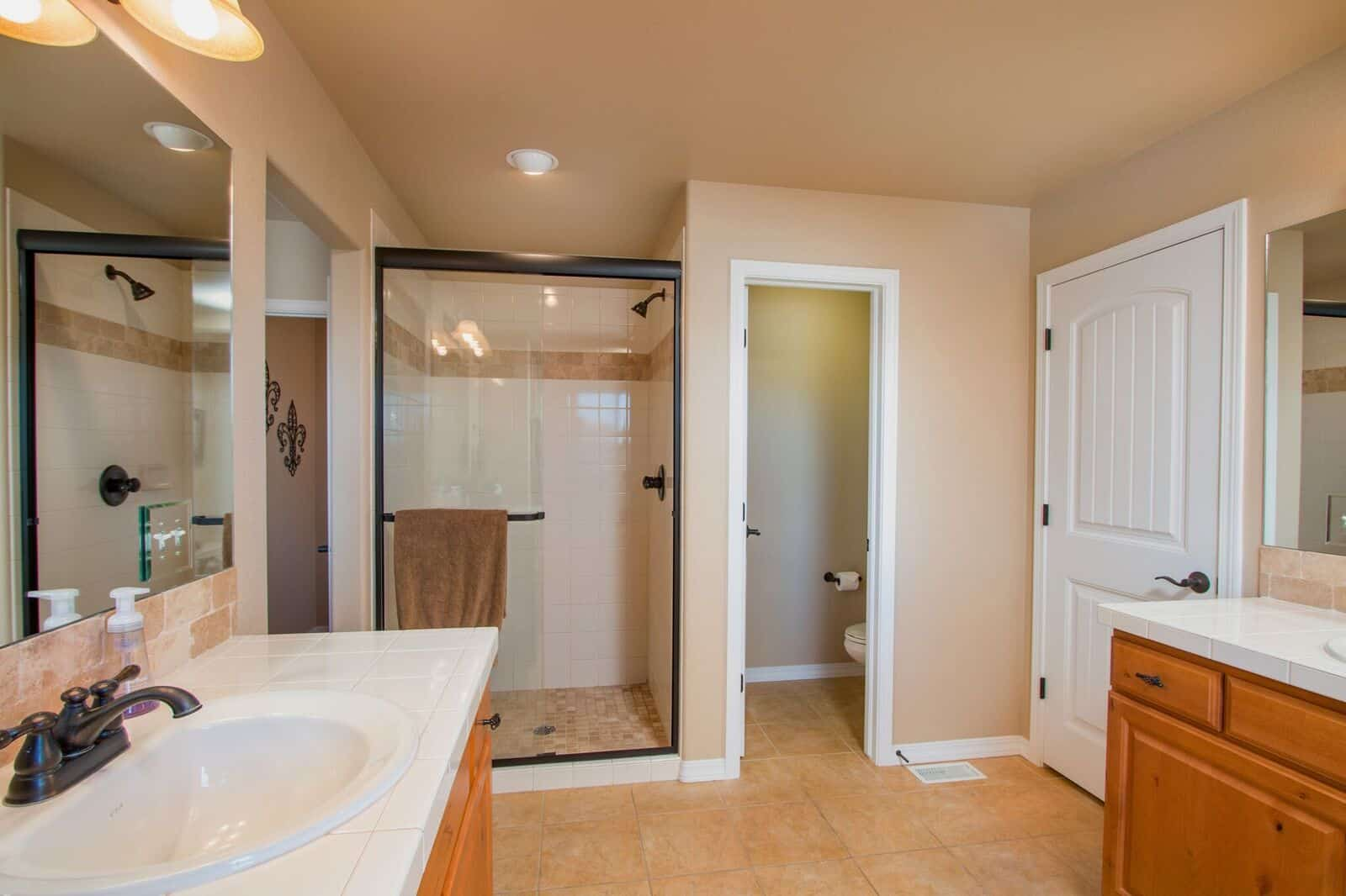 Master Bathroom w/Tiled Shower and Dual Vanities