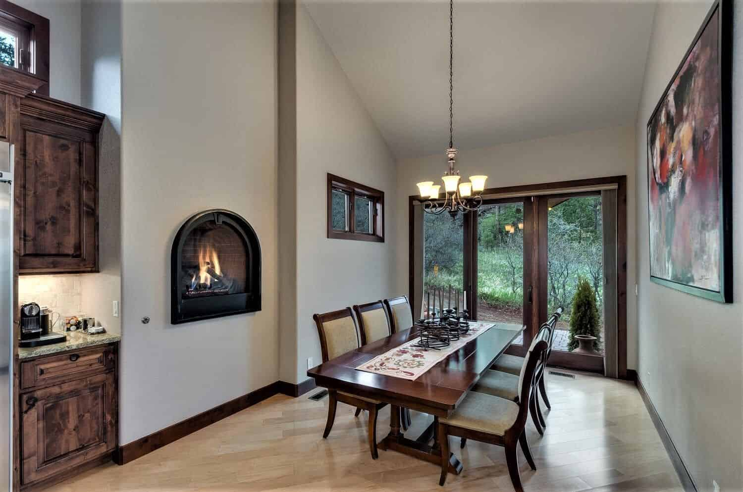 Dining Room with Fireplace and Walkout to Paver Patio