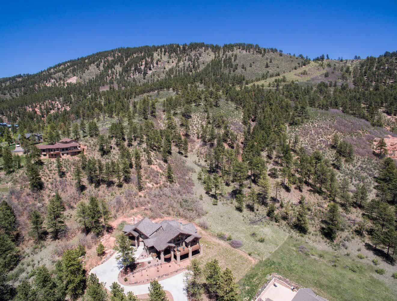 This Home adjoins Pikes National Forest to the East for Access