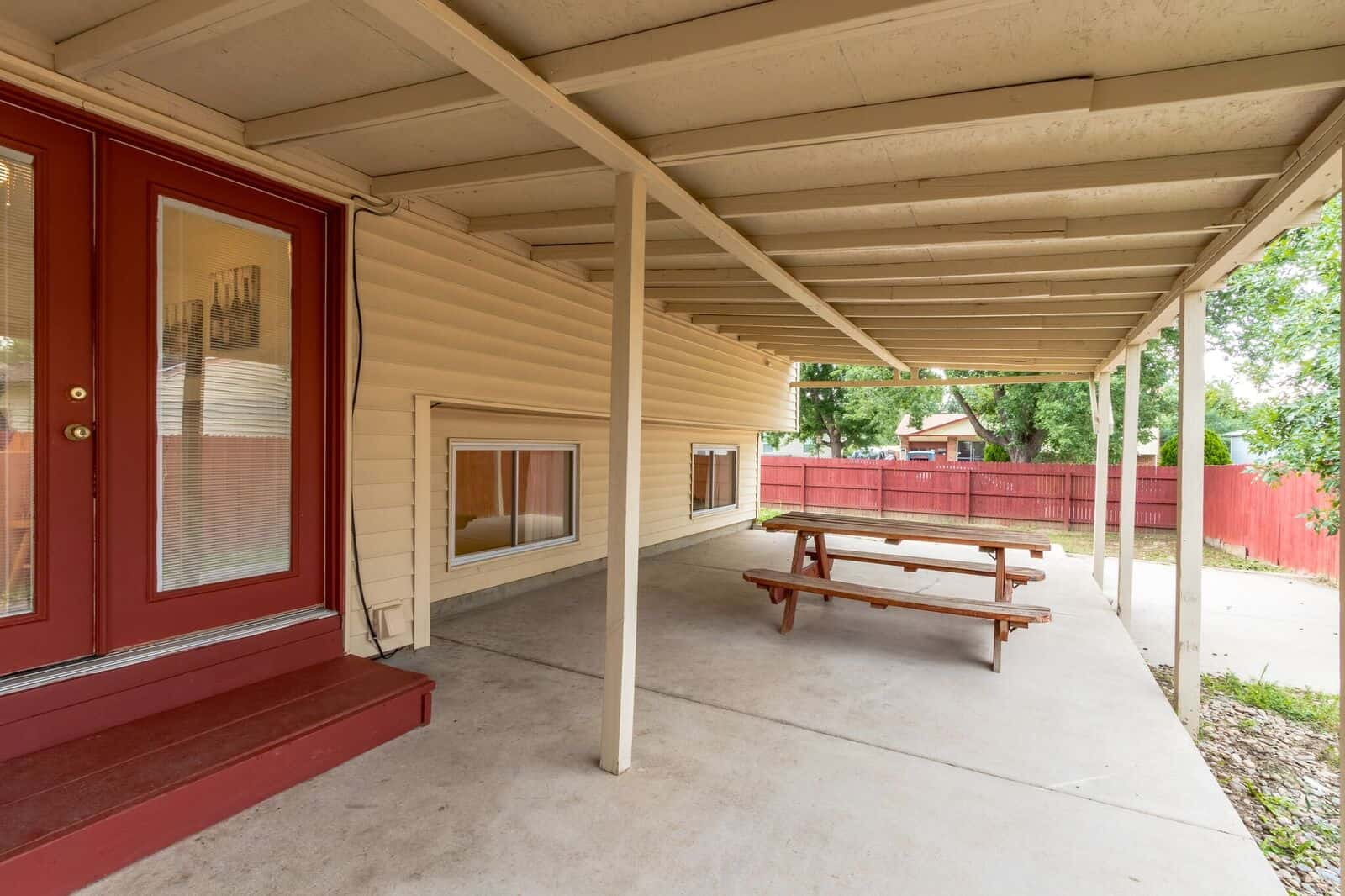 Doors from Kitchen to Large Covered Patio and Fenced Yard