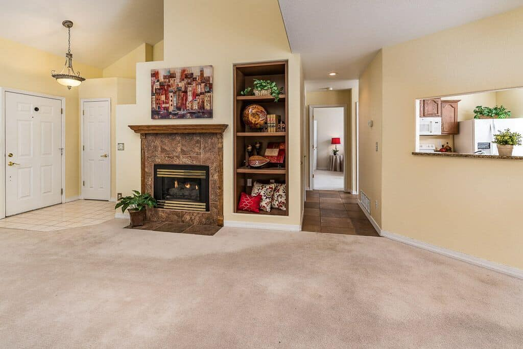 Living Room with Pass Thru to Kitchen and Hall to Master Bedroom