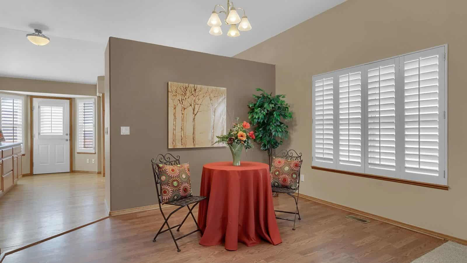 Dining Room with Plantation Shutters into the Kitchen