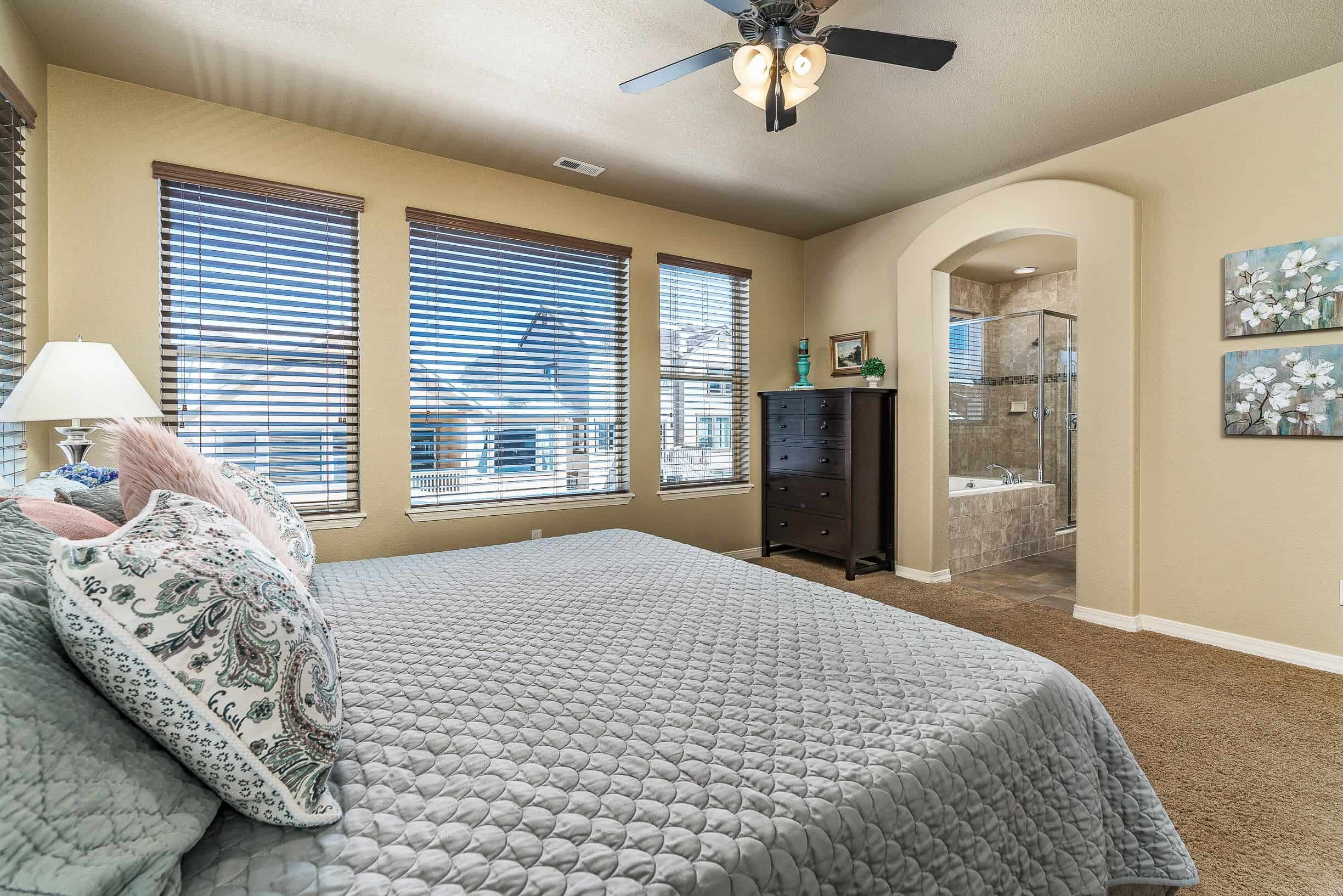 Master Bedroom with Large Windows into Master Bath