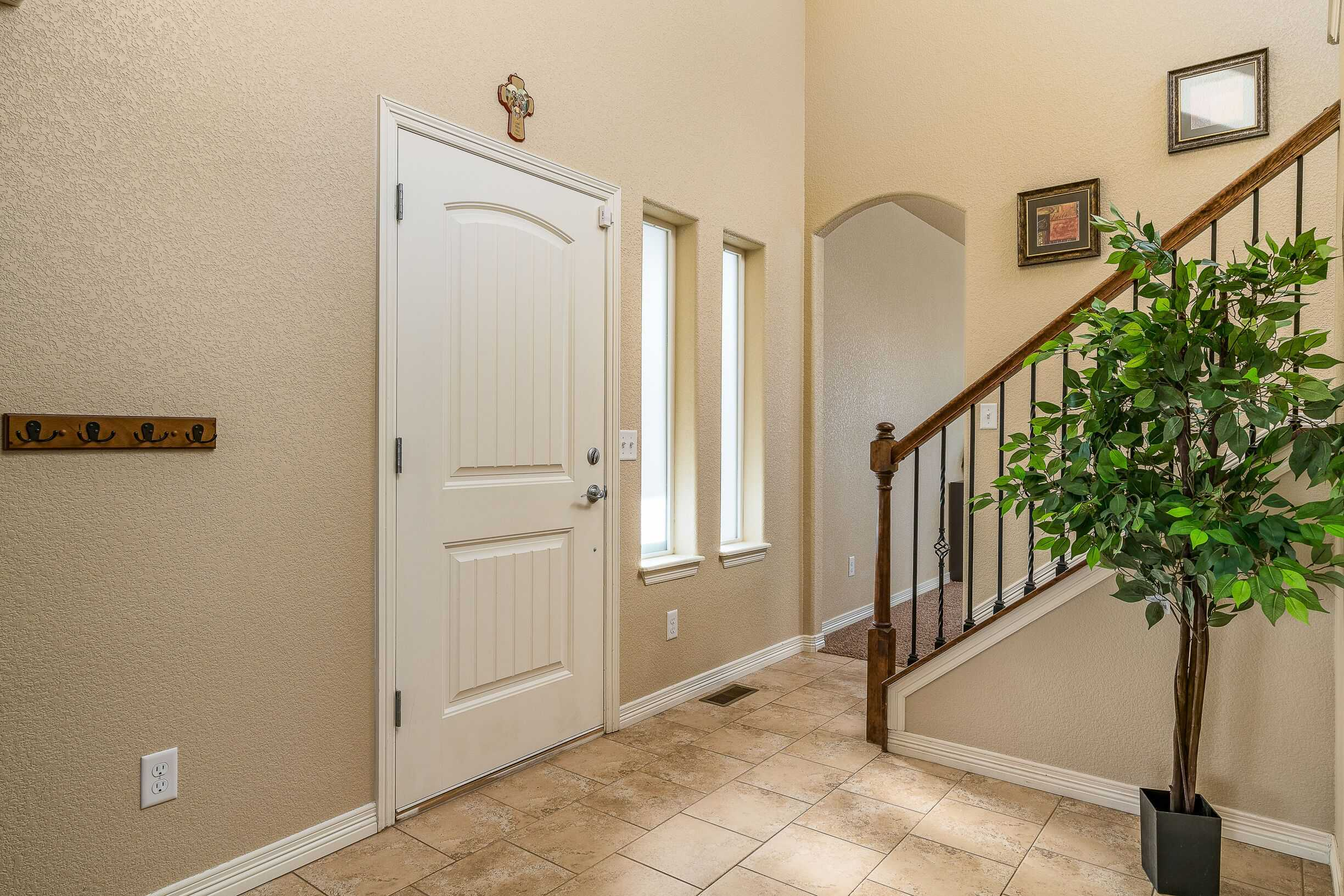 Entry with Archway to Front Living Room