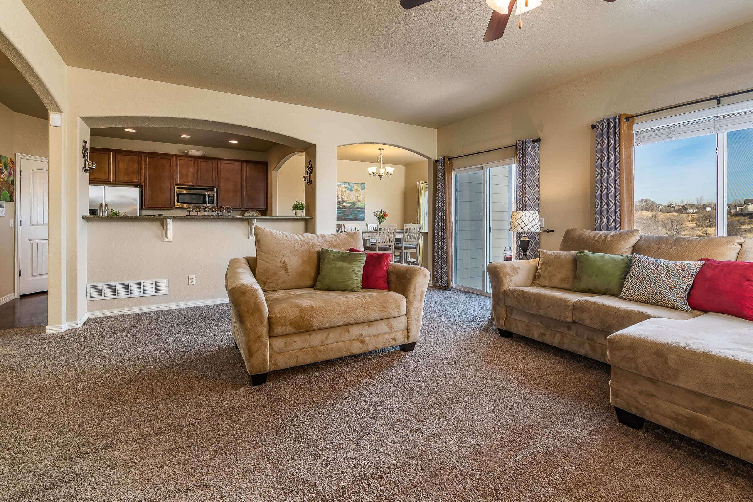 Great Room into Kitchen and Walkout to Patio