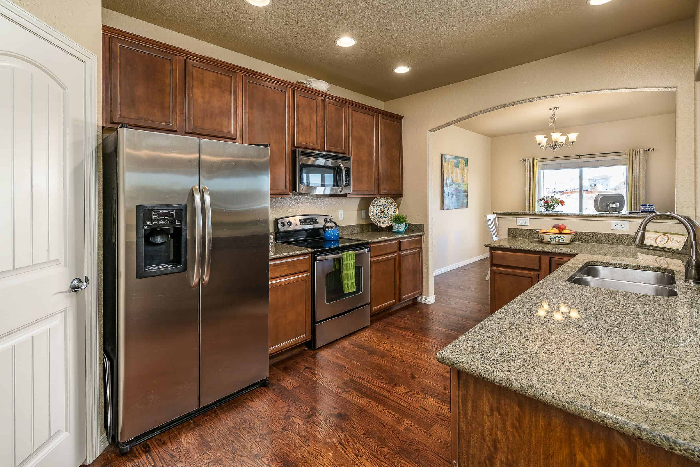 Kitchen with Walk-In Pantry and Entry to DR