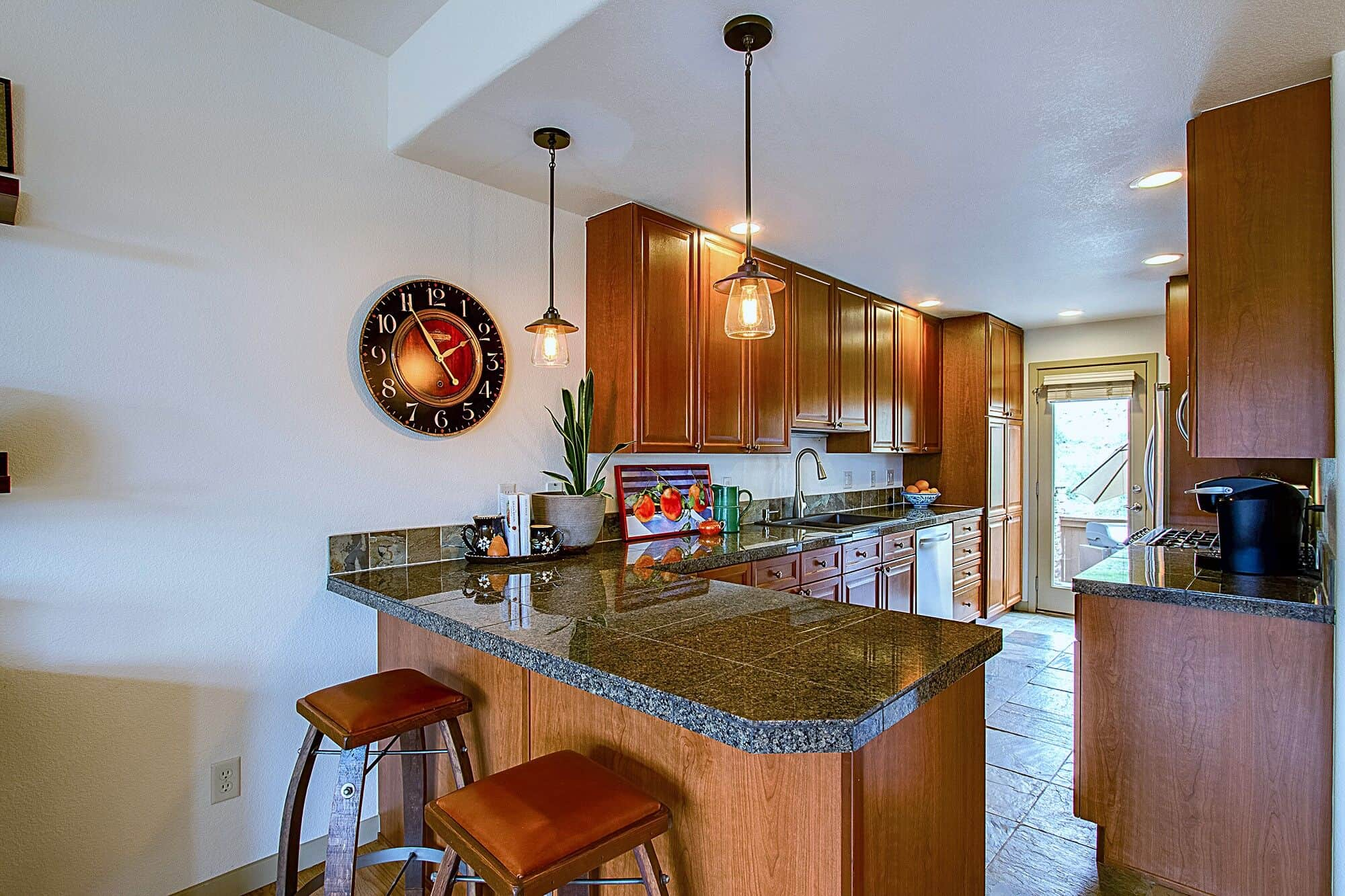 Kitchen Counter Bar and Granite Countertops with Pendant Lights