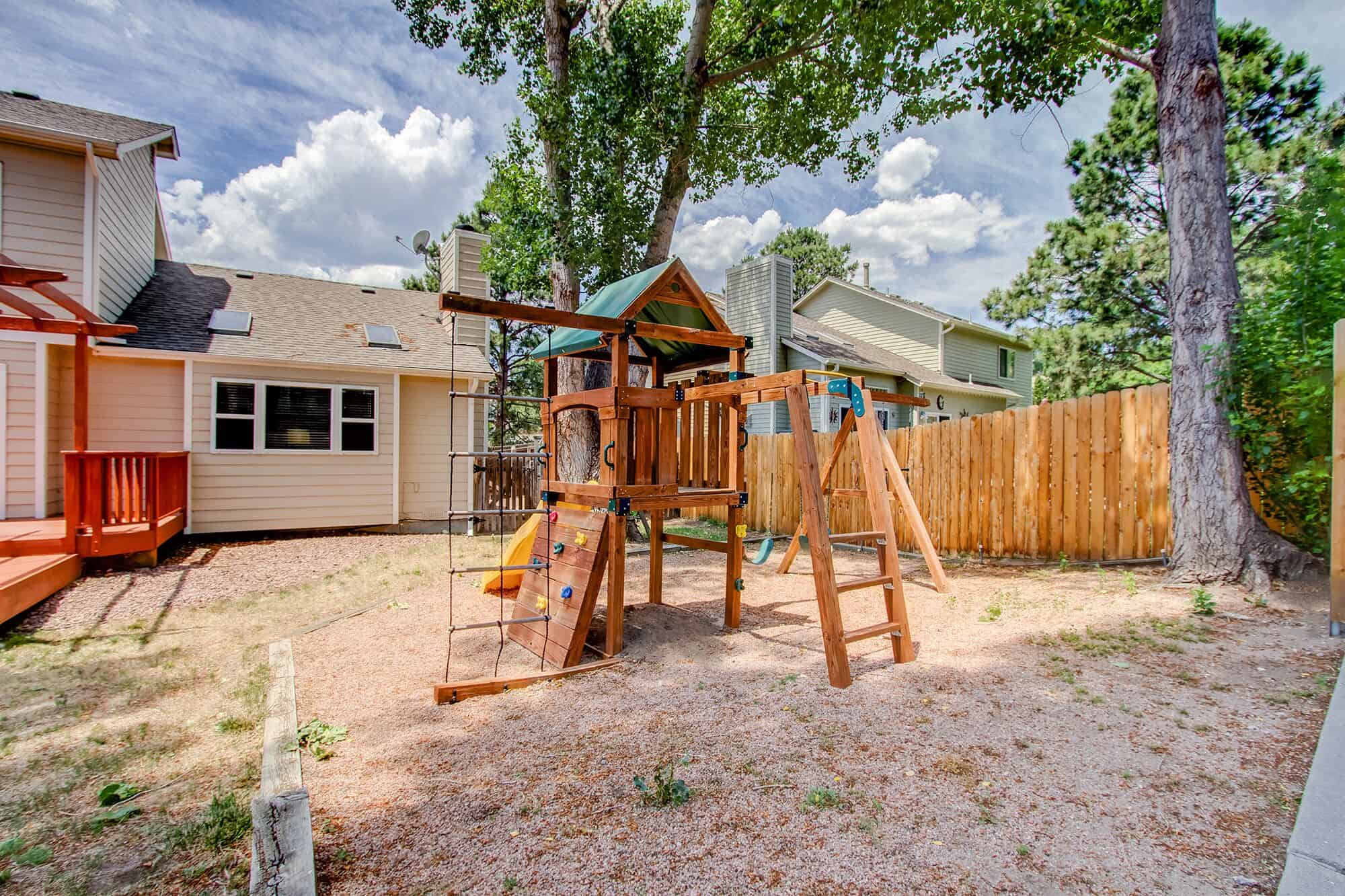 Playset and Dog Run on Side Yard with Storage Shed