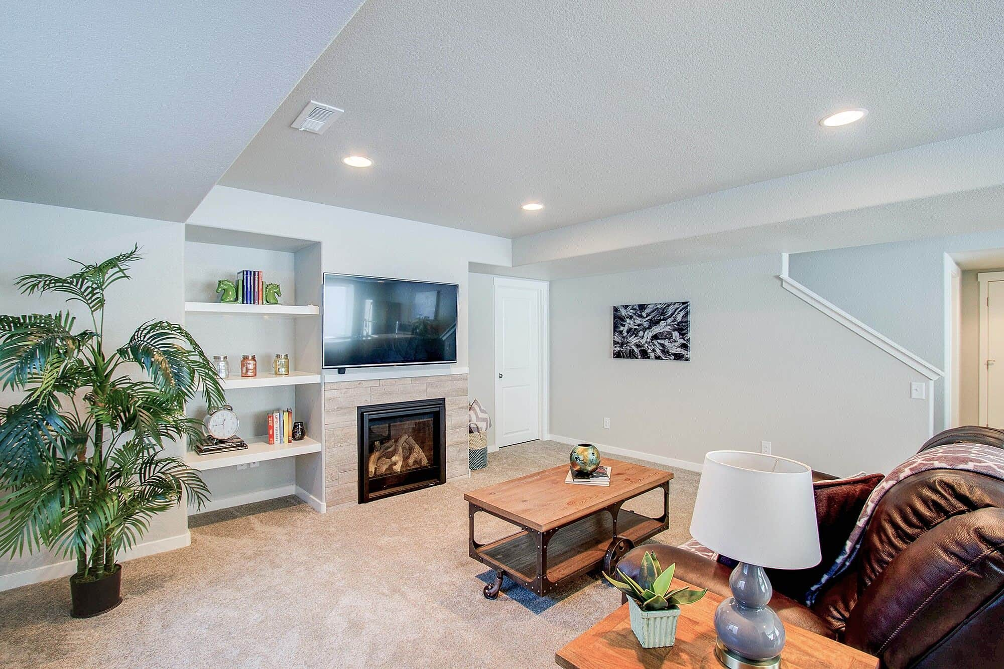 Rec Room with Fireplace and Built-In Shelves