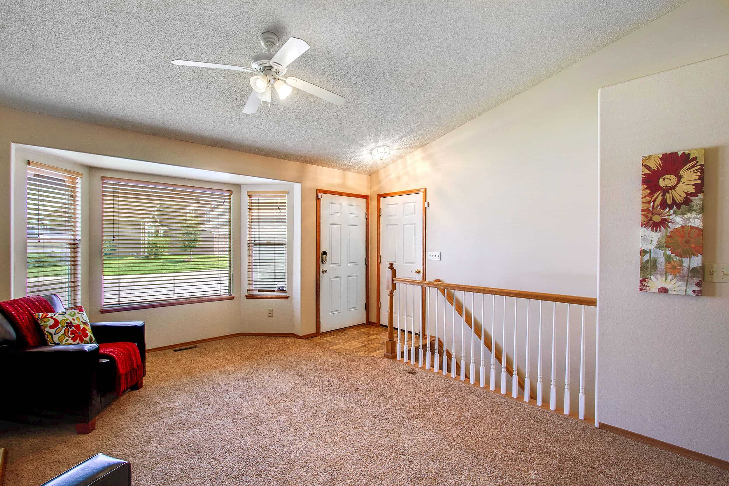 Entry with Large Bay Window in Living Room
