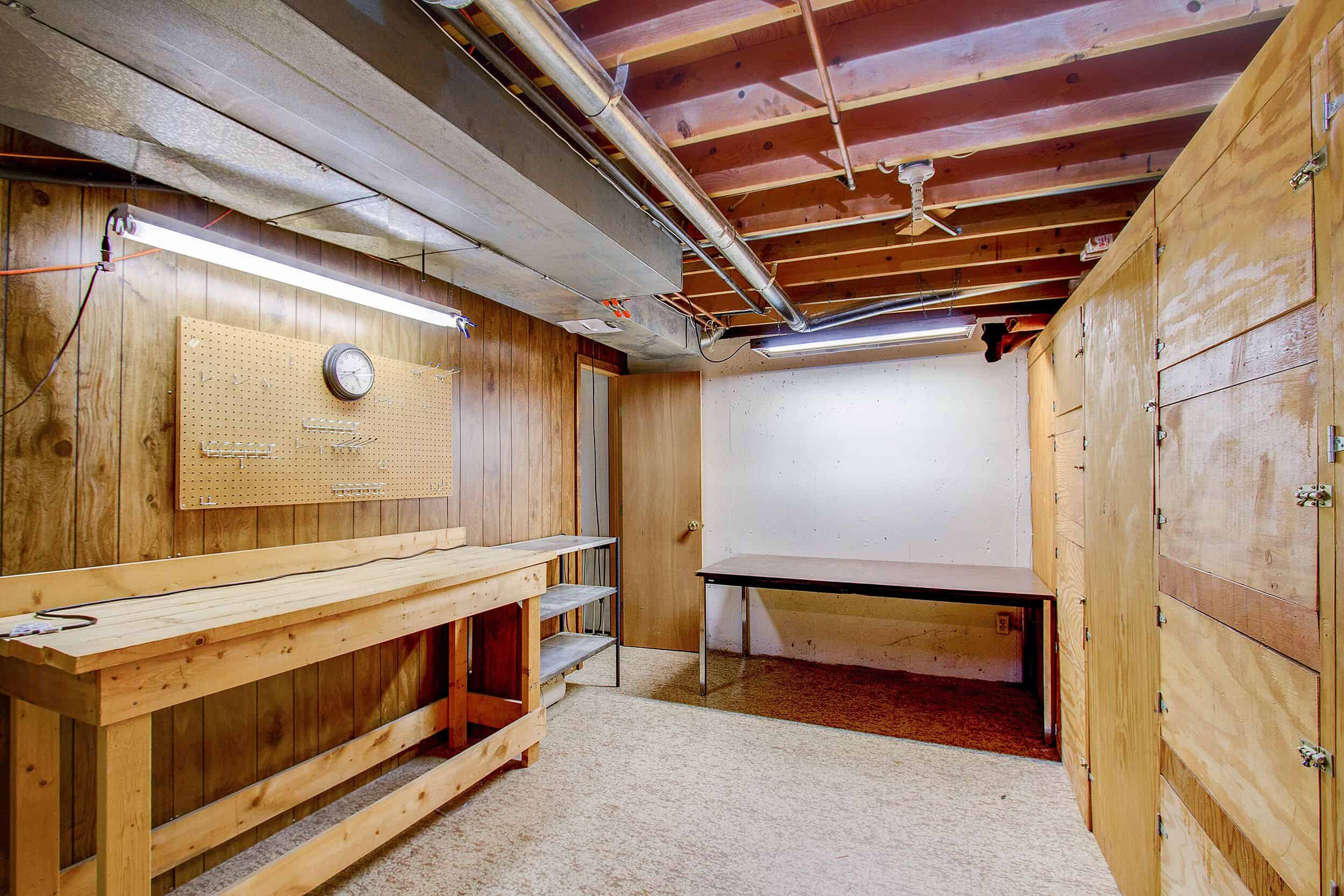 Basement Storage with Work Bench and Mechanical Room