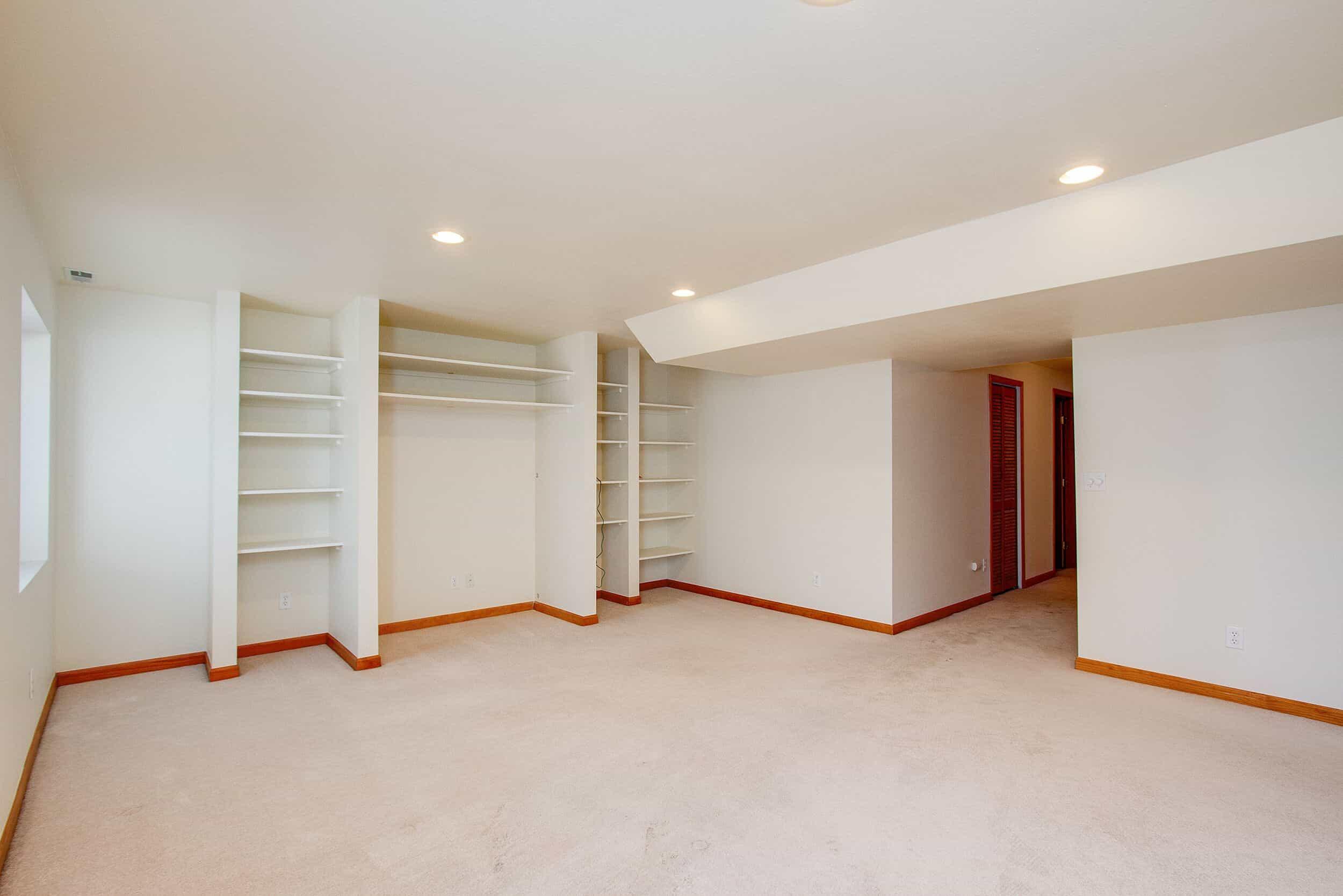 Basement Family Room with Built-In Shelves