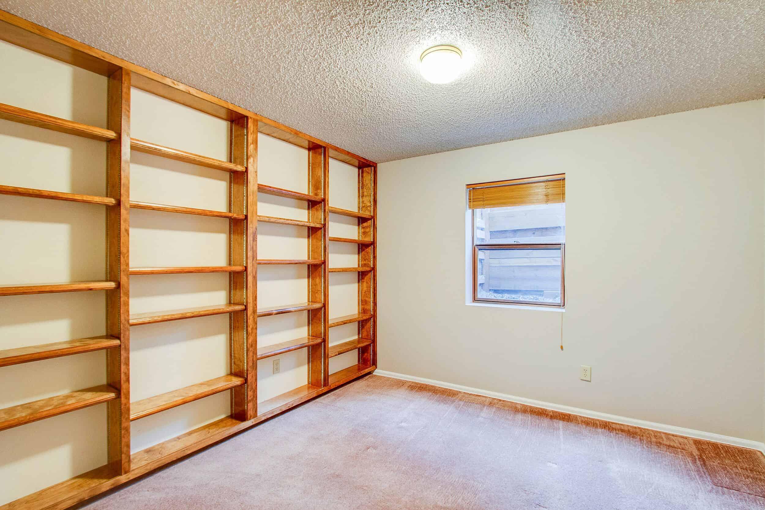 Basement Office with Built-In Bookshelves