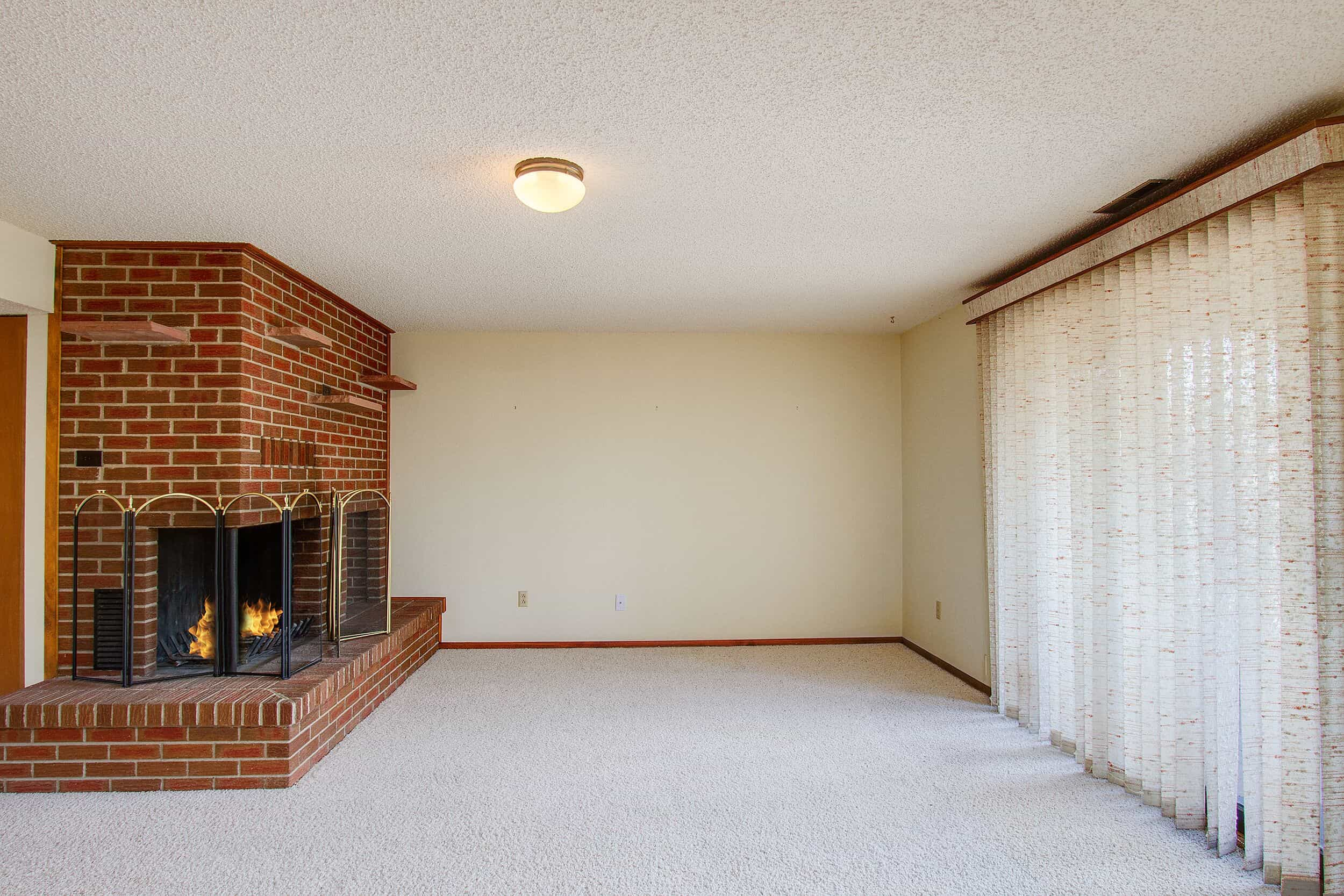 Basement Recreation Room with Brick Surround
