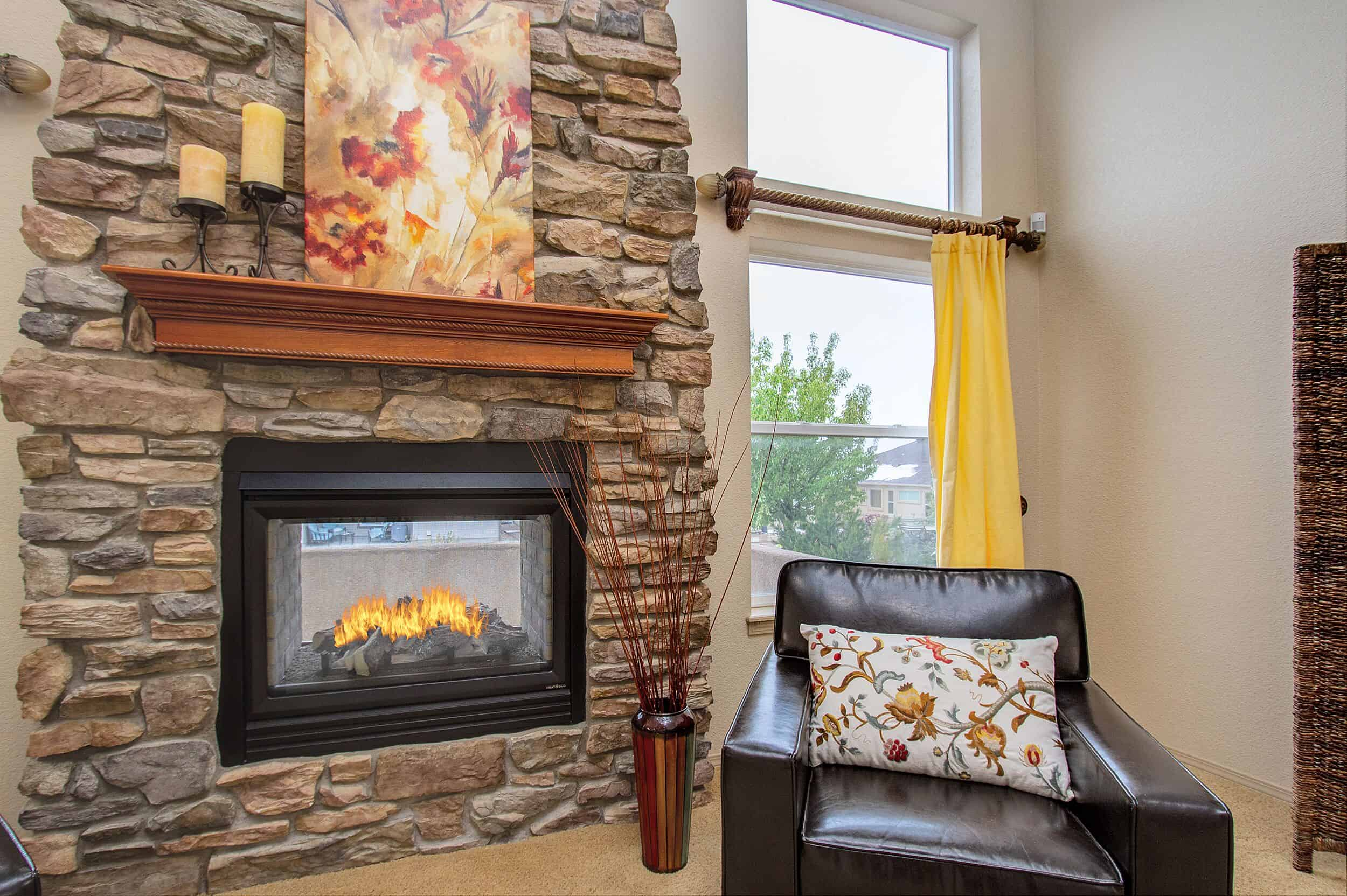 Floor to Ceiling Stacked Stone Fireplace