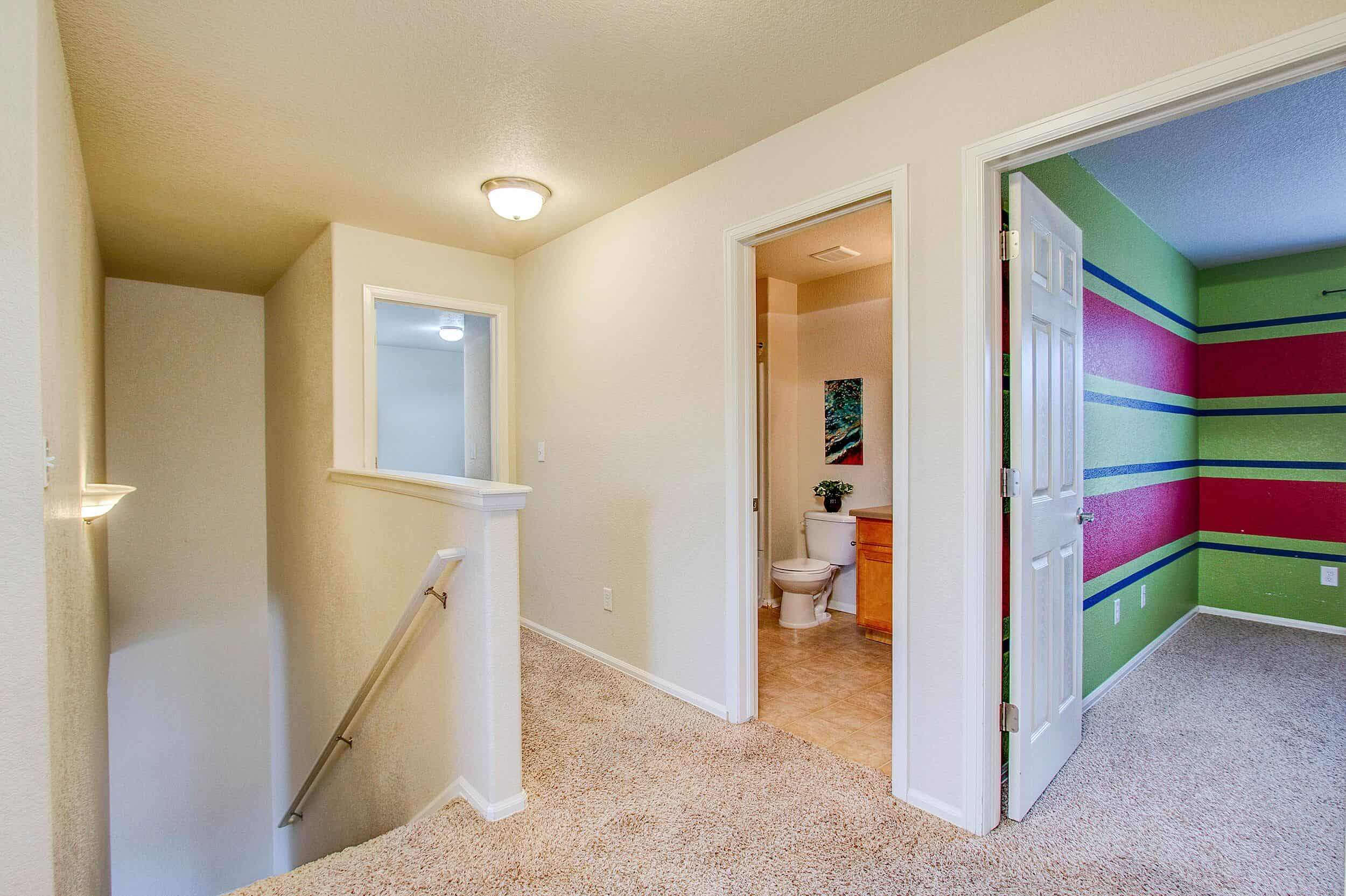 Upper Level Landing into Bedrooms and Bathroom