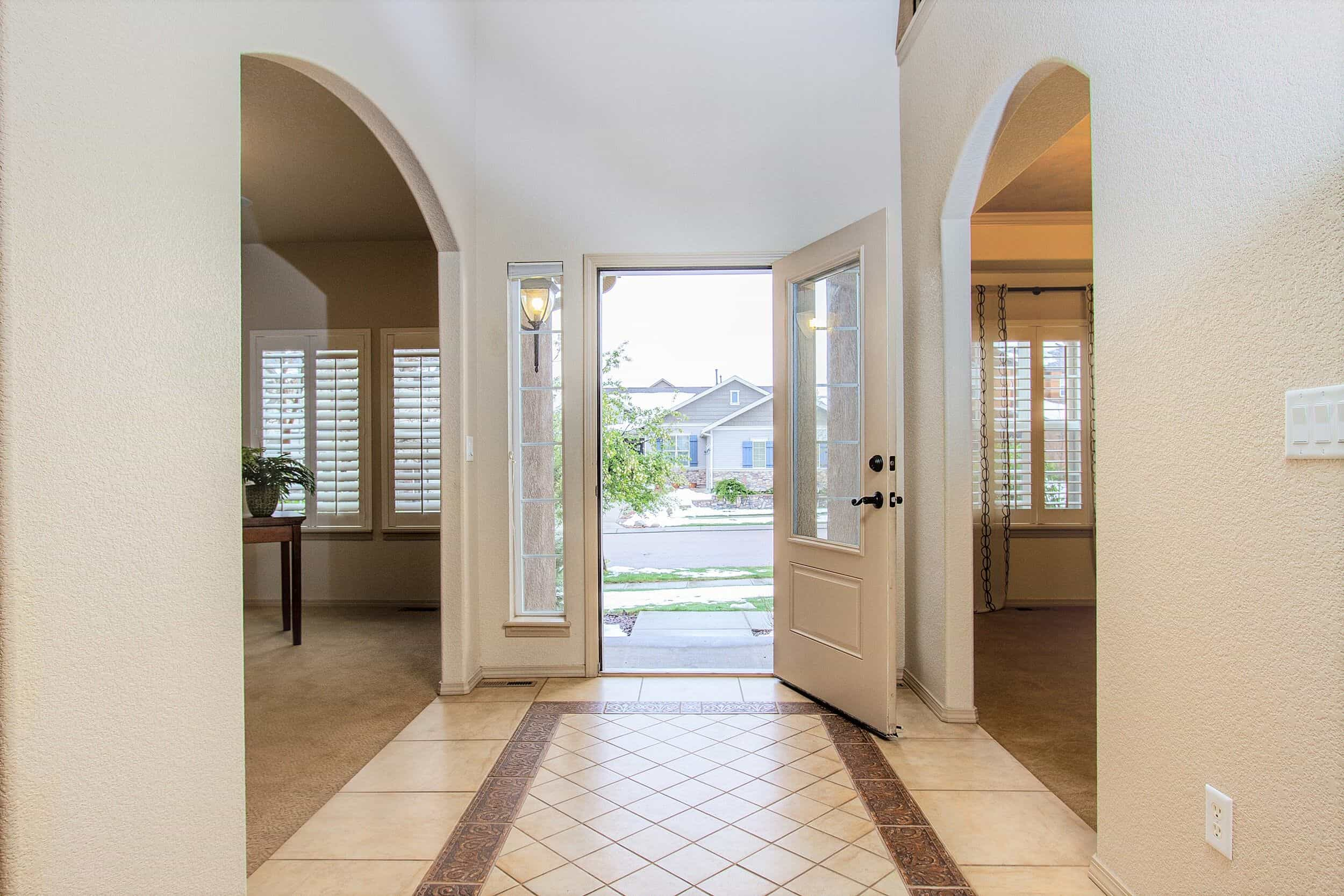 Soaring Entry with Decorative Tile Inset
