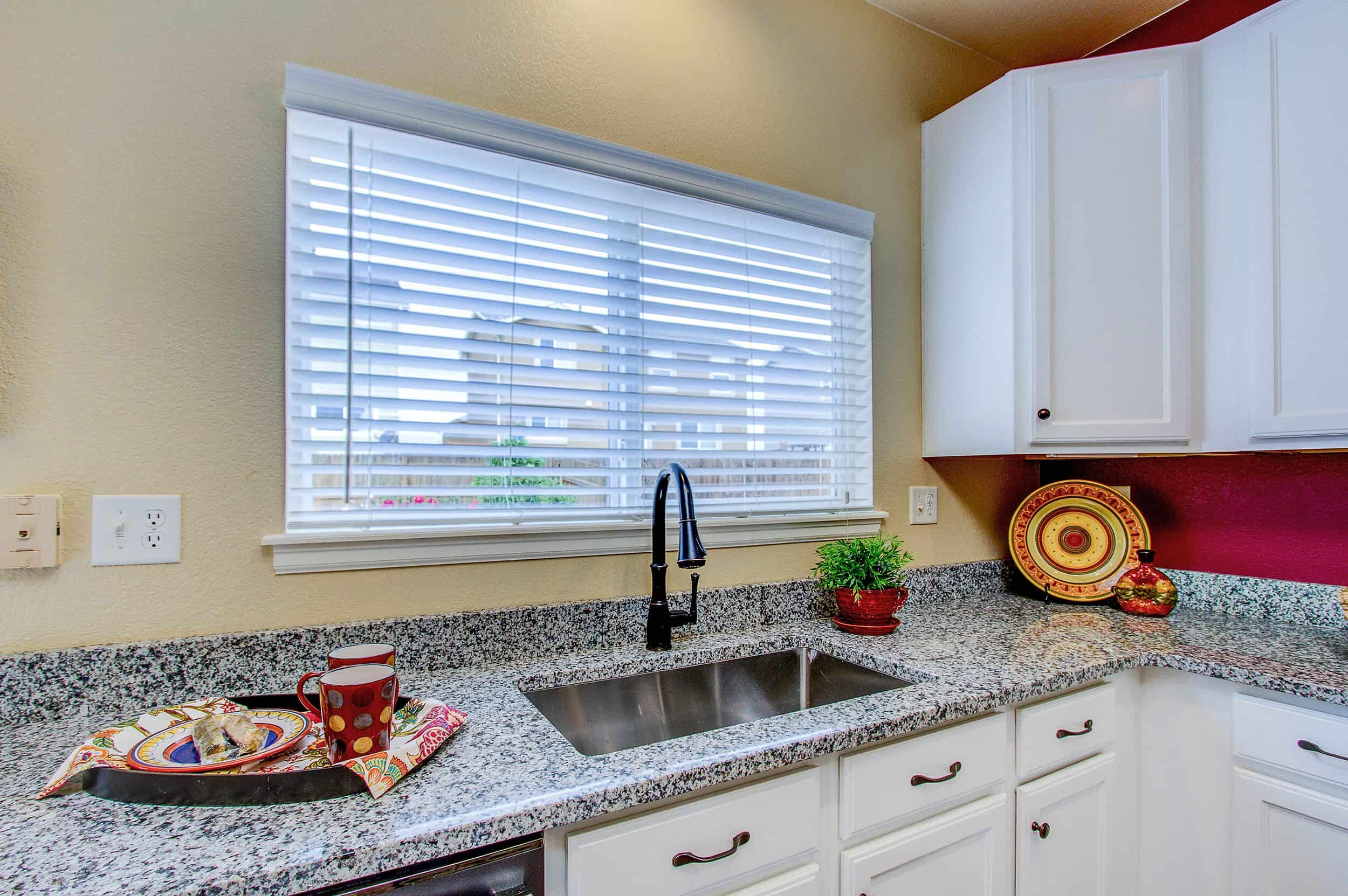 Updated Kitchen with Granite Counters and Farm Sink