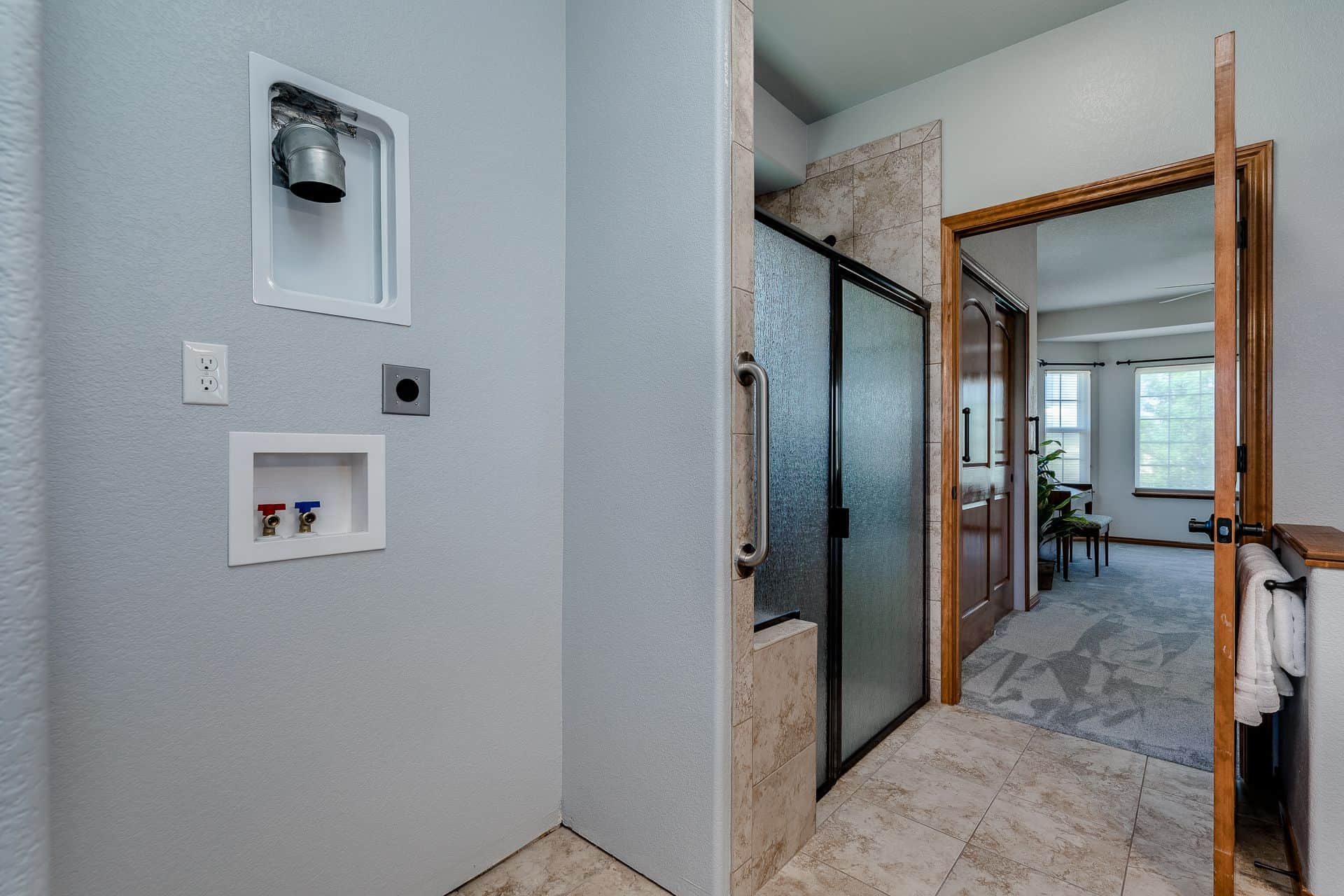Ensuite Bath and Separate Laundry Hookup