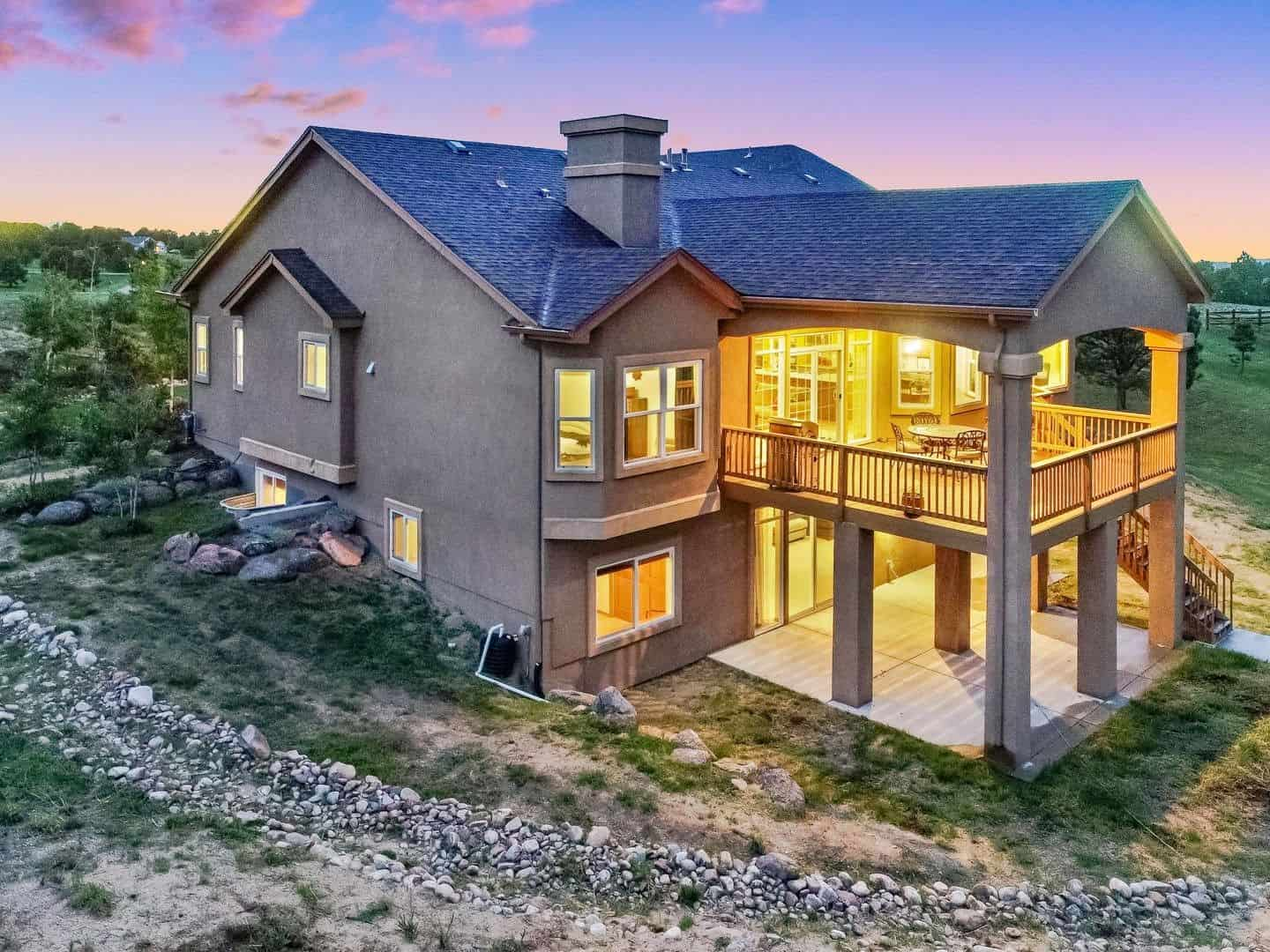 Sunset Views of Rear Covered Deck and Covered Patio